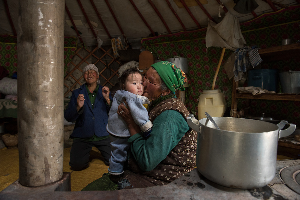 Family in Kazakh ger<br /> Altai Mountains<br /> Mongolia's largest ethnic minority<br /> Western Mongolia