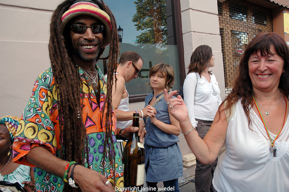 multi-cultural group dancing and socialising at Notting Hill annual Carnival.