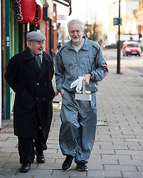 © Licensed to London News Pictures. 28/11/2015. London, UK. Labour Party leader JEREMY CORBYN  chats to an elderly man while carrying coffee after leavings his home in Islington, north London this morning (Sat). Jeremy Corbyn has come under pressure from his own party over a potential vote on UK military involvement in Syria. Photo credit: Ben Cawthra/LNP