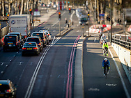 London, England - January 07, 2018: Cyclists using the TFL Cycle Superhighway in Upper Thames Street, London. Opened in 2016.