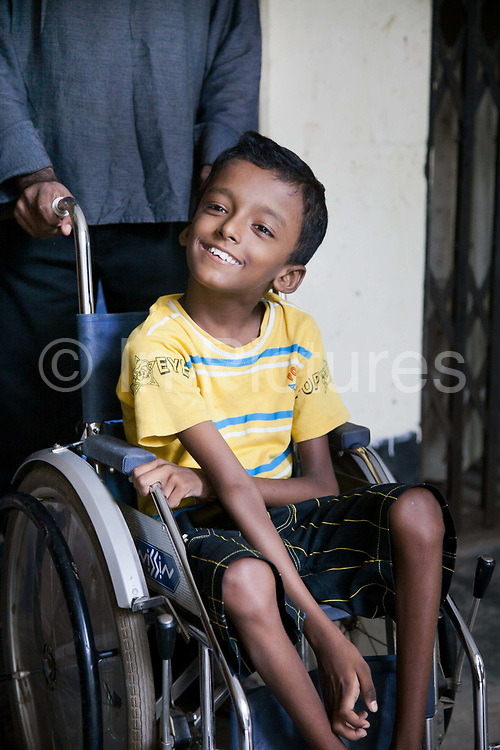 Dhaka, Bangladesh. Shihab, attending physiotherapy session on a Wednesday morning.The Stars Foundation visiting CSID. Centre for Services and Information on Disability (CSID) is a charity working for integrating disabled children into mainstream society. Children in one of CSID 's integrated pre-schools. The project is supported financially by Actionaid.