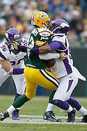 GREEN BAY, WI - DECEMBER 2:  Aaron Rodgers #12 of the Green Bay Packers is sacked by Everson Griffen #97 of the Minnesota Vikings at Lambeau Field on December 2, 2012 in Green Bay, Wisconsin.  The Packers defeated the Vikings 23-14.  (Photo by Wesley Hitt/Getty Images) *** Local Caption *** Aaron Rodgers; Everson Griffen Sports photography by Wesley Hitt photography with images from the NFL, NCAA and Arkansas Razorbacks.  Hitt photography in based in Fayetteville, Arkansas where he shoots Commercial Photography, Editorial Photography, Advertising Photography, Stock Photography and People Photography