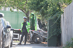 ©Licensed to London News Pictures 14/09/2020  <br /> Kidbrooke, UK. The green bin lorry. A bin lorry has crashed into multiple cars and a house in Kidbrooke, South East London. A number of people have been injured police, fire and ambulance are all on scene. credit:Grant Falvey/LNP