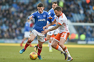 Portsmouth Forward, Conor Chaplin (19) and Blackpool Midfielder, Jay Spearing (44) during the EFL Sky Bet League 1 match between Portsmouth and Blackpool at Fratton Park, Portsmouth, England on 24 February 2018. Picture by Adam Rivers.