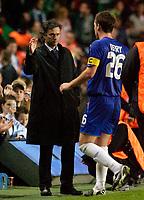 Photo: Daniel Hambury.<br />Chelsea v Real Betis. UEFA Champions League.<br />19/10/2005.<br />Chelsea's manager Jose Mourinho congratulates skipper John Terry on a job well done.