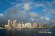 A full rainbow circles Waikiki.