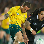 Quade Cooper, Australia, kicks while challenged by Ma'a Nonu, New Zealand,  during the New Zealand V Australia Semi Final match at the IRB Rugby World Cup tournament, Eden Park, Auckland, New Zealand, 16th October 2011. Photo Tim Clayton...