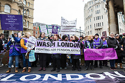 London, UK. 19th January, 2019. Women from WASPI London join thousands of other women taking part in the Global Women's March from BBC Broadcasting House to Trafalgar Square to attend a Bread & Roses Rally Against Austerity organised by Women's March London. Inspired by the 1912 Bread & Roses protests which revolutionised workers' rights for women and in the light of Brexit, the organisers called for assurances from the Government in ending policies of austerity which lead to economic oppression, violence against women, the gender pay gap, racism, fascism, institutional sexual harassment and the hostile environment experienced by marginalised groups.