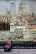 Canaletto hoarding with CCTV cameras at London Bridge train station. London, UK. The new and the old as this old master painting is in contrast to a modern security camera.