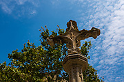 Cross outside the 9th century Monestir de Sant Cugat del Valles, near Barcelona, Catalonia.