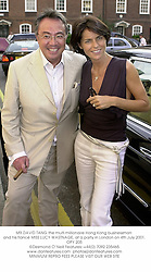 MR DAVID TANG the multi millionaire Hong Kong businessman and his fiancŽ MISS LUCY WASTNAGE, at a party in London on 4th July 2001.OPY 205