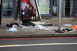 © Licensed to London News Pictures. 11/12/2020. London, UK. Broken glass at a bus stop in Stamford Hill, north London after a car which mounted on pavement and plough into pedestrians just after 9.30am. Five people have been rushed to the hospital. Photo credit: Dinendra Haria/LNP