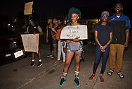 Jalessia Franklin at a vigil for Alton Sterling at the Triple S Food Mart,  in front of a mural by  Jo Hines spray of Alton Sterling in Baton Rouge, La., Wednesday, July 6, 2016Wednesday, July 6, 2016.