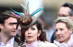 A female racegoer during Ladies Day of the 2018 Cheltenham Festival at Cheltenham Racecourse.
