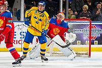 KELOWNA, BC - DECEMBER 18: Rickard Hugg #26 of Team Sweden looks for the pass ahead of Petr Kochetkov #20 of Team Russia  at Prospera Place on December 18, 2018 in Kelowna, Canada. (Photo by Marissa Baecker/Getty Images)***Local Caption***