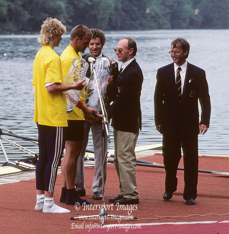 Lucerne, SWITZERLAND.  Left,  GER W1X Gold Medalist, Beate SCHRAMM and GER M1X  Thomas LANGE winners. . John BOULTBEE and Dennis OSWALD presenting the medals. 1992 FISA World Cup. 1992 FISA World Cup Regatta, Lucerne. Lake Rotsee.  [Mandatory Credit: Peter Spurrier: Intersport Images] 1992 Lucerne International Regatta and World Cup, Switzerland