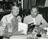 1976 Radio commentator and interviewer, Gregg Hunter, seen interviewing Oscar winning writer, Abby Mann, during his KIEV radio show at the Brown Derby Restaurant on Vine St. in Hollywood