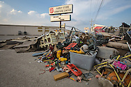 Denham Springs, Louisiana on Sept 1, 2016. Contents from homes and buisinesses line the street in the floods aftermath. This Salvation Army Store on Florida Blvd. reamins closed two weeks after the storm.
