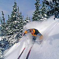 A skier descends powder glades at Crystal Mountain Ski Area.