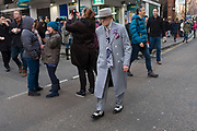 Eldery gentleman wearing a Zoot Suit during Chinese New Year celebrations in central London, United Kingdom. Tens of thousands of people gathered in the West End filling the streets and joining in with the festival atmosphere.