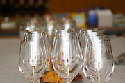 Wine glasses in the tasting room. Vinarija Citluk winery in Citluk near Mostar, part of Hercegovina Vino, Mostar. Federation Bosne i Hercegovine. Bosnia Herzegovina, Europe.