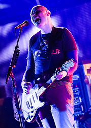 © Licensed to London News Pictures. 01/12/14. London, UK.   The Smashing Pumpkins performing live at Wembley Arena on 22/7/13. In this picture Billy Corgan.  The Smashing Pumpkins are due to play a special intimate one-off show at London's KOKO this friday 5/12/14 in support of their eighth studio album Monuments to an Elegy, to be released December 8th.  The special lineup for these performances will include Brad Wilk (Rage Against The Machine) on drums and Mark Stoermer (The Killers) on bass joining The Smashing Pumpkins' Billy Corgan and Jeff Schroeder.  The KOKO date will be one of four world wide dates, the others being Germany on the 30 November, Paris on the 6th December, and New York on the 8th December.   **** FILE PICTURE DATED 22 JULY 2013 *** Photo credit : Richard Isaac/LNP