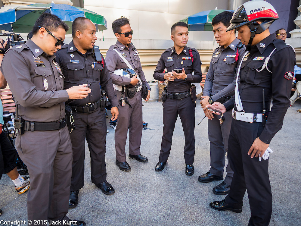 19 AUGUST 2015 - BANGKOK, THAILAND: Thai police at Erawan Shrine during the shrine's reopening. Erawan Shrine in Bangkok reopened Wednesday morning after more than 20 people were killed and more than 100 injured in a bombing at the shrine Monday, August 17, 2015. The shrine is a popular tourist attraction in the center of Bangkok's high end shopping district and is an important religious site for Thais. No one has claimed responsibility for the bombing.      PHOTO BY JACK KURTZ