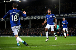Everton's Theo Walcott celebrates scoring his side's first goal of the game during the Premier League match at Goodison Park, Liverpool.