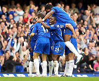 Photo: Daniel Hambury.<br />Chelsea v Blackburn Rovers. The Barclays Premiership.<br />29/10/2005.<br />Chelsea's players mob Frank Lampard after he scored to make it 3-2.