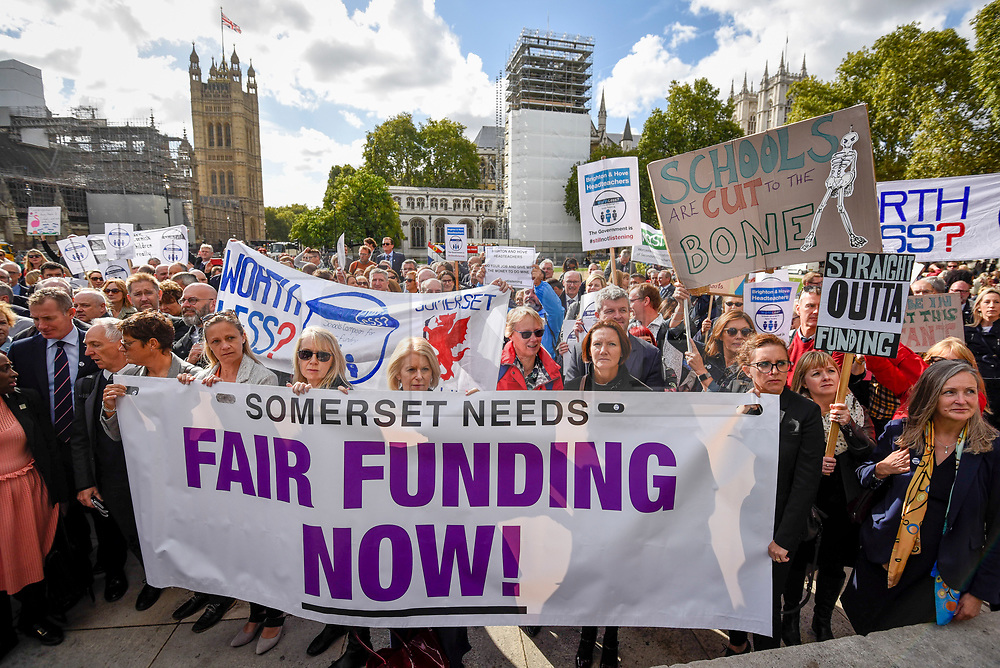 © Licensed to London News Pictures. 28/09/2018. LONDON, UK. Head teachers with placards and banners join hundreds of other head teachers at a rally in Parliament Square to demand extra funding for schools ahead of a petition being delivered to Number 11 Downing Street.  With a reported reduction in per student funding in real terms since 2010, members of the National Union of Head Teachers and the Association of School and College Leaders attending the rally also warn of increasing class sizes, staff cuts, and reduced subject choice.  Photo credit: Stephen Chung/LNP
