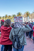"""""""Not one woman at the table"""" reads the signheld by protesters at Justin Herman Plaza at the International Women's Day rally before the San Francisco march."""