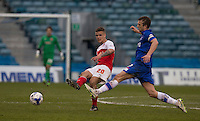 Fleetwood Town's Tyler Forbes passes under pressure from Gillingham's Doug Loft<br /> <br /> Photographer Stephen White/CameraSport<br /> <br /> Football - The Football League Sky Bet League One - Gillingham v Fleetwood Town -  Friday 3rd April 2015 - MEMS Priestfield Stadium - Gillingham<br /> <br /> © CameraSport - 43 Linden Ave. Countesthorpe. Leicester. England. LE8 5PG - Tel: +44 (0) 116 277 4147 - admin@camerasport.com - www.camerasport.com