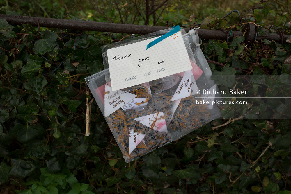 A detail of a handmade package of notes at the Clifton Suspension Bridge and river Severn gorge, historically a commmon location for suicides and where the mental health charity Samaritans raise awareness for vulernable people over the Christmas and New year holiday, on 26th December 2019, in Bristol, England.