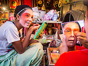 18 JANUARY 2015 - BANGKOK, THAILAND: Performers with the Sai Yong Hong Opera Troupe put on their make up before a performance at the Chaomae Thapthim Shrine, a Chinese shrine in a working class neighborhood of Bangkok near the Chulalongkorn University campus. The troupe's nine night performance at the shrine is an annual tradition and is the start of the Lunar New Year celebrations in the neighborhood. The performance is the shrine's way of thanking the Gods for making the year that is ending a successful one. Lunar New Year, also called Chinese New Year, is officially February 19 this year. Teochew opera is a form of Chinese opera that is popular in Thailand and Malaysia.             PHOTO BY JACK KURTZ