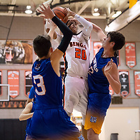 In Gallup, Quincy Smith (20) of Gallup tries to score against Orrin Chapman (52) and Teegan Clawson (3) of Bloomfield in the paint on Thursday. Gallup won 68-47.