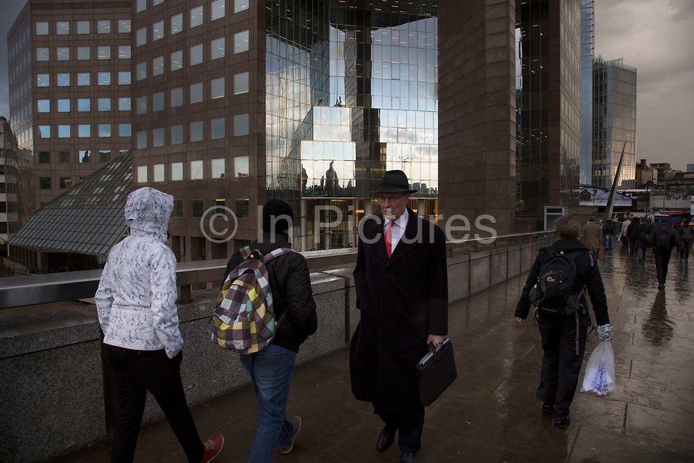 Reflections of a stormy sky on the Price Waterhouse Coopers building in London, UK.