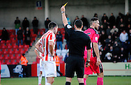 Terry Gornell is shown yellow card during the The FA Cup match between Cheltenham Town and Dover Athletic at Whaddon Road, Cheltenham, England on 7 December 2014.