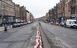 Edinburgh, Scotland, UK. 1 May 2020. Views of Edinburgh as coronavirus lockdown continues in Scotland. Streets remain deserted and shops and restaurants closed and many boarded up. Pictured; Very little traffic on Leith Walk.   Iain Masterton/Alamy Live News