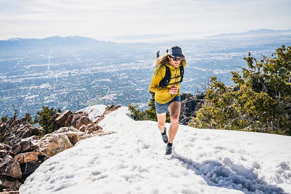 Joe Grant hits the summit of Mount Olympus, Wasatch Range, Utah.