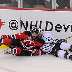 June 2, 2012: New Jersey Devils right wing Stephen Gionta (11) levels Los Angeles Kings center Colin Fraser (24) with a hit during third period action in game 2 of the NHL Stanley Cup Final between the New Jersey Devils and the Los Angeles Kings at the Prudential Center in Newark, N.J. The Kings defeated the Devils 2-1 in overtime.