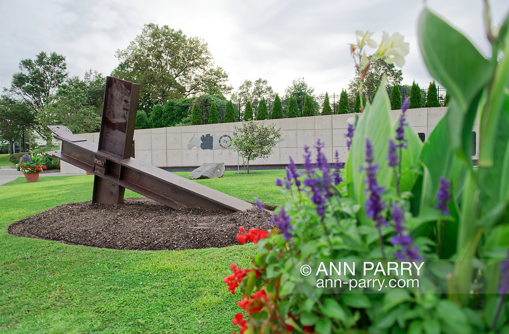 East Meadow, New York, U.S. September 10, 2020. Under overcast sky, the cross shaped structure at far left - iron beams from Twin Towers in NYC - is at the Nassau County Eisenhower Park September 11, 2001 Memorial, which originally was to be location of event that afternoon commemorating 19th anniversary of September 11 terrorist attacks with Remembrance Ceremony. Because of rain prediction, the event was held at nearby Harry Chapin Lakeside Theater.
