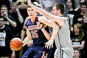 SHOT 2/14/13 10:35:58 PM - Arizona's Kaleb Tarczewski #35 posts up against Colorado's Shane Harris-Tunks #15 during their regular season Pac-12 basketball game at the Coors Event Center on the Colorado campus in Boulder, Co. Colorado won the game 71-58. (Photo by Marc Piscotty / © 2013)