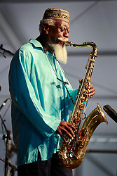 02 May 2014. New Orleans, Louisiana.<br /> Pharoah Sanders at the New Orleans Jazz and Heritage Festival. <br /> Photo; Charlie Varley/varleypix.com