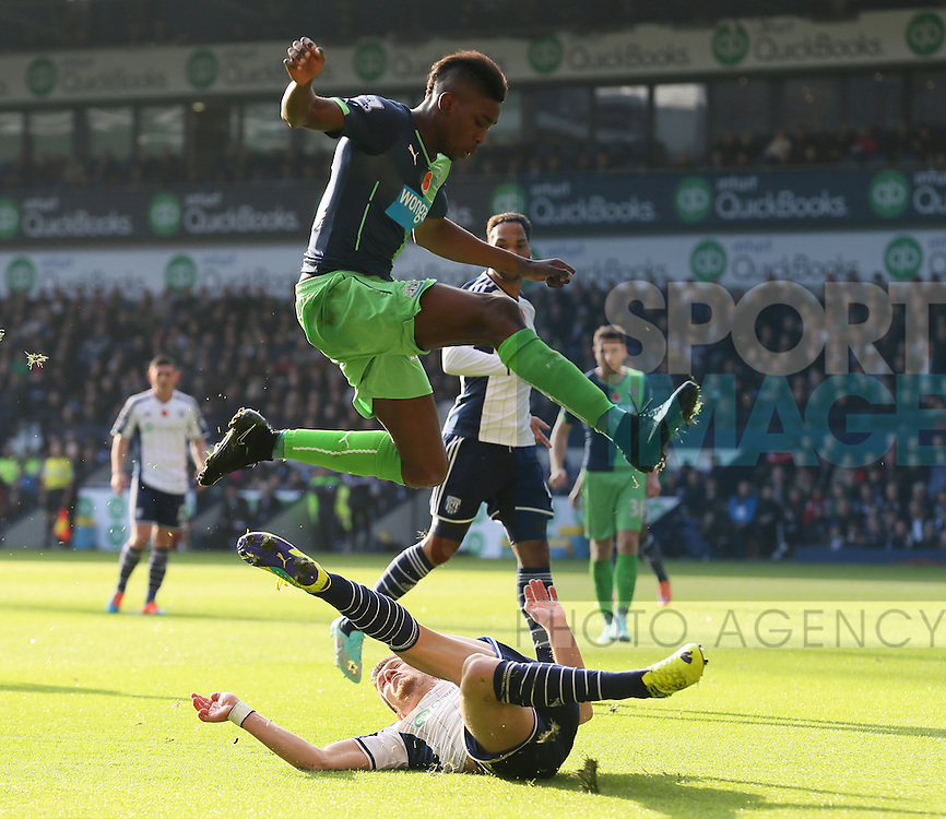 Sammy Ameobi of Newcastle United leaps over a tackle by Sebastien Pocognoci of West Bromwich Albion - Barclays Premier League - WBA vs Newcastle Utd - Hawthorns Stadium - West Bromwich - England - 9th November 2014  - Picture Simon Bellis/Sportimage
