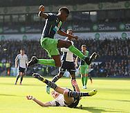 Sammy Ameobi of Newcastle United leaps over a tackle by Sebastien Pocognoci of West Bromwich Albion - Barclays Premier League - WBA vs Newcastle Utd - Hawthorns Stadium - West Bromwich - England - 9th November 2014  - Picture Simon Bellis/Sportimage
