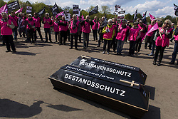 April 27, 2017 - Berlin, Germany - About 150 people rally in the Berlin government district against the development of the employment retirement legislation. The Protesters call for a stop of the conversion of a self-funded, private direct insurance to a company pension. Two coffins with the inscription 'stock protection' and 'trust protection' are placed in front of the German Bundestag. (Credit Image: © Jan Scheunert via ZUMA Wire)