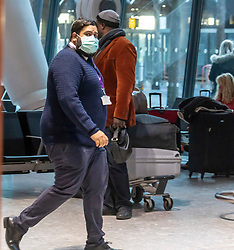 © Licensed to London News Pictures. 29/01/2020. London, UK. An airport worker with a protective mask at London Heathrow Terminal 5 as the last BA flight from China are expected to arrive this afternoon. The coronavirus virus has infected more than 40000 people across Asia in the past few weeks. Photo credit: Alex Lentati/LNP
