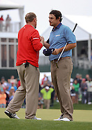 05APR15  JB Holmes accepts congratulations from runner up Johnson Wagner on the 18th green at the conclusion of Sunday's Final Round Playoff of The Shell Houston Open at The Golf Club of Houston in Humble, Texas. (photo credit : kenneth e. dennis/kendennisphoto.com)