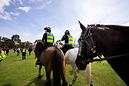 MELBOURNE, VIC - SEPTEMBER 19: Mounted Police walk through the Elsternwick park as they push protesters back during the Freedom protest on September 19, 2020 in Melbourne, Australia. Freedom protests are being held in Melbourne every Saturday and Sunday in response to the governments COVID-19 restrictions and continuing removal of liberties despite new cases being on the decline. Victoria recorded a further 21 new cases overnight along with 7 deaths. (Photo by Dave Hewison/Speed Media)