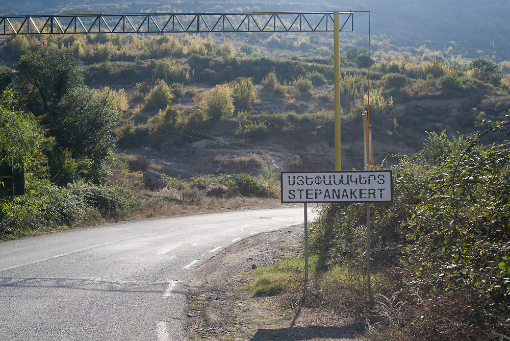 A sign on the side of the highway indicates the city of Stepanakert, capital of the disputed region of Nagorno Karabakh, also known as Artsakh. The region declared independence in 1991 and is controlled by ethnic Armenians, but it is internationally recognized as part of Azerbaijan.<br /> <br /> (September 21, 2016)